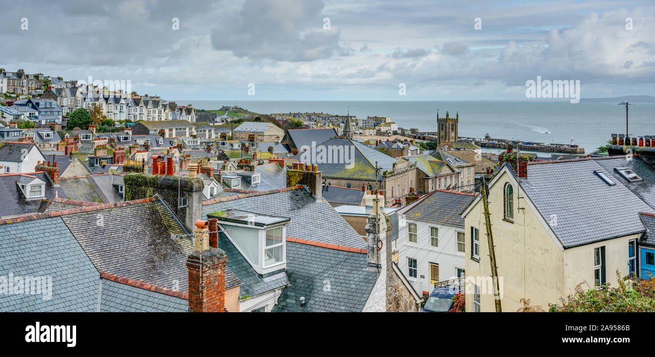 A panoramic taken from the top of St.Ives in Cornwall, England looking down over the town to the church and harbour at the edge of the Atlantic ocean. Stock Photo