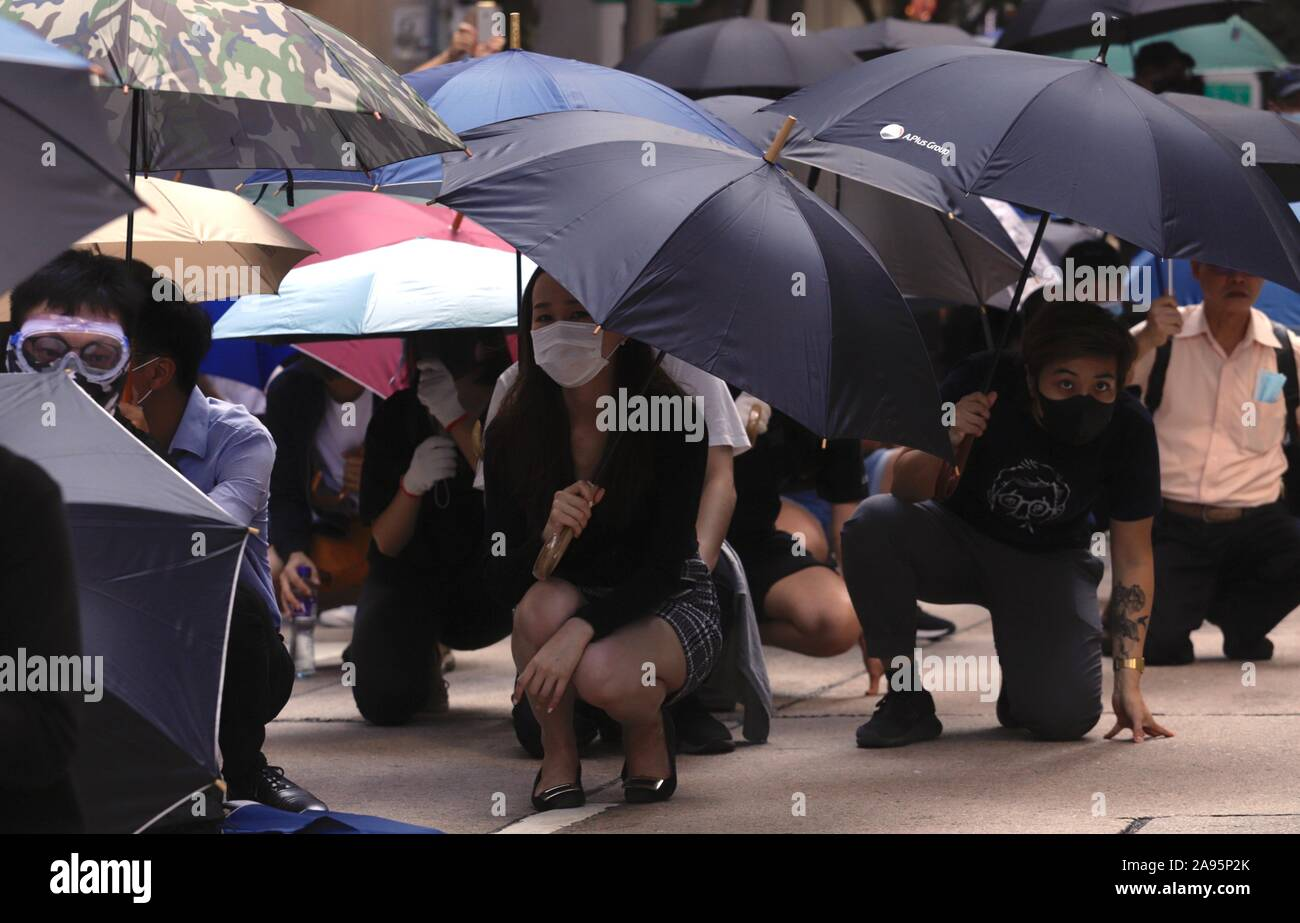 https://c8.alamy.com/comp/2A95P2K/hong-kong-china-13th-nov-2019-elegantly-dressed-office-lady-take-part-in-the-lunch-hour-flashmob-protest-in-central-occupying-and-blocking-the-main-avenue-confronting-riot-policemen-in-defiancenov-13-2019-hong-kongzumaliau-chung-ren-credit-liau-chung-renzuma-wirealamy-live-news-2A95P2K.jpg