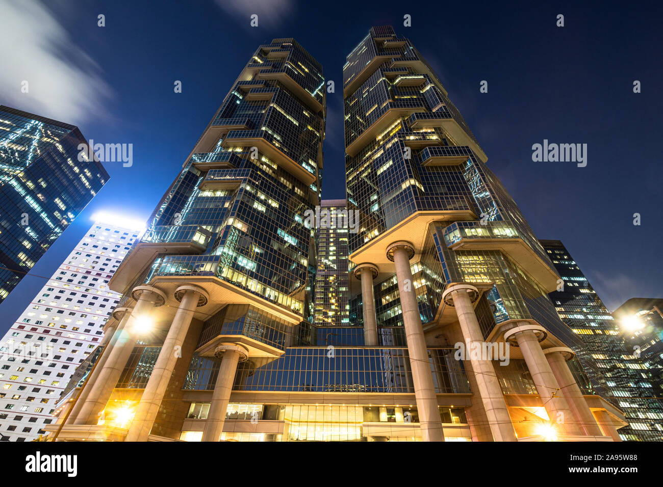 Low angle view of modern skyscrapers in the Central business district in Hong Kong island at night in Hong Kong SAR, China Stock Photo