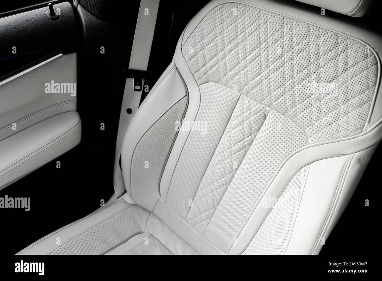 White Leather Interior Of The Luxury Modern Car Perforated White Leather Comfortable Seats With Stitching Modern Car Interior Details Car Detailing Stock Photo Alamy