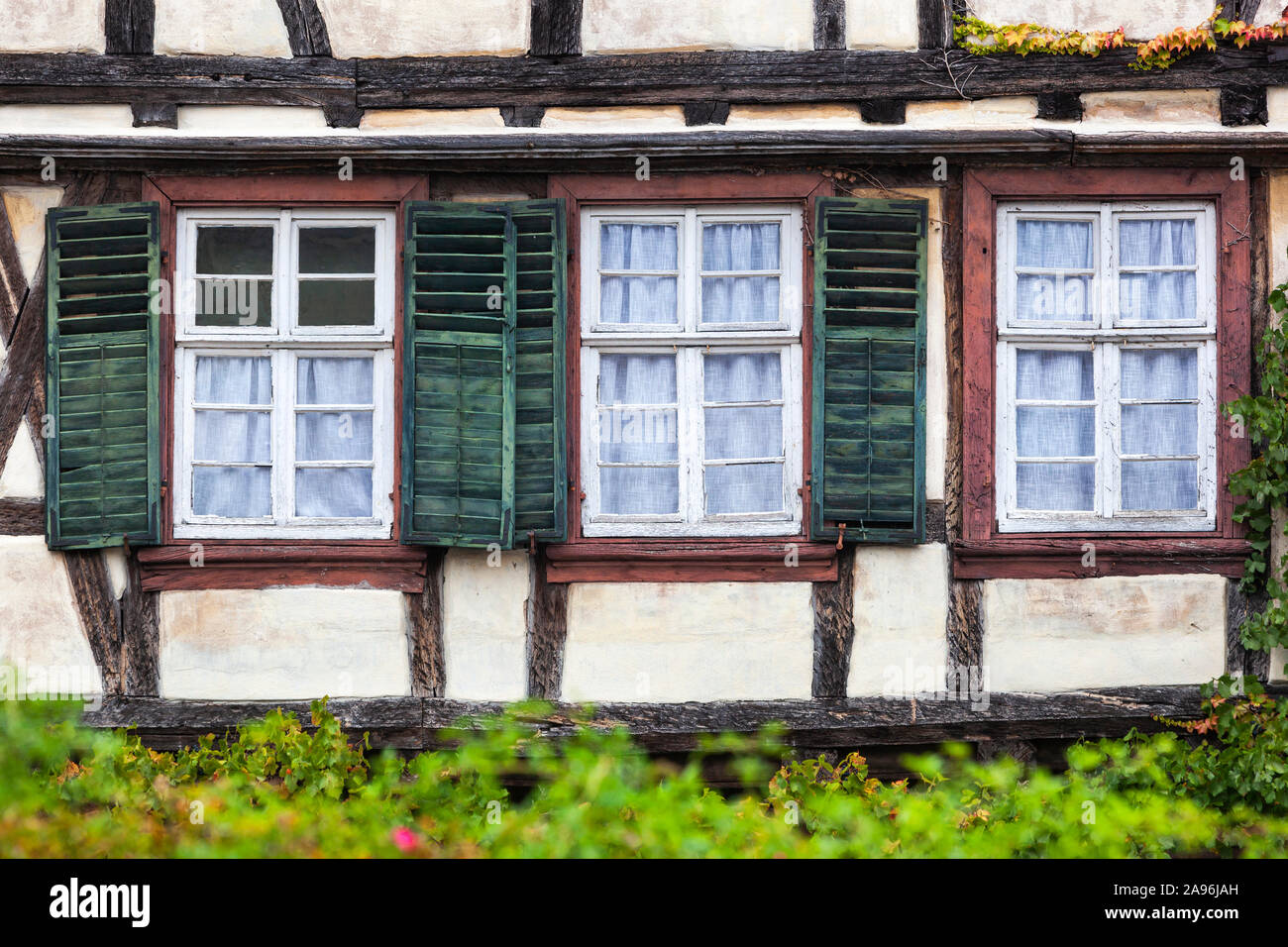 Old Vintage Window With Green Shutters Of A Half Timbered