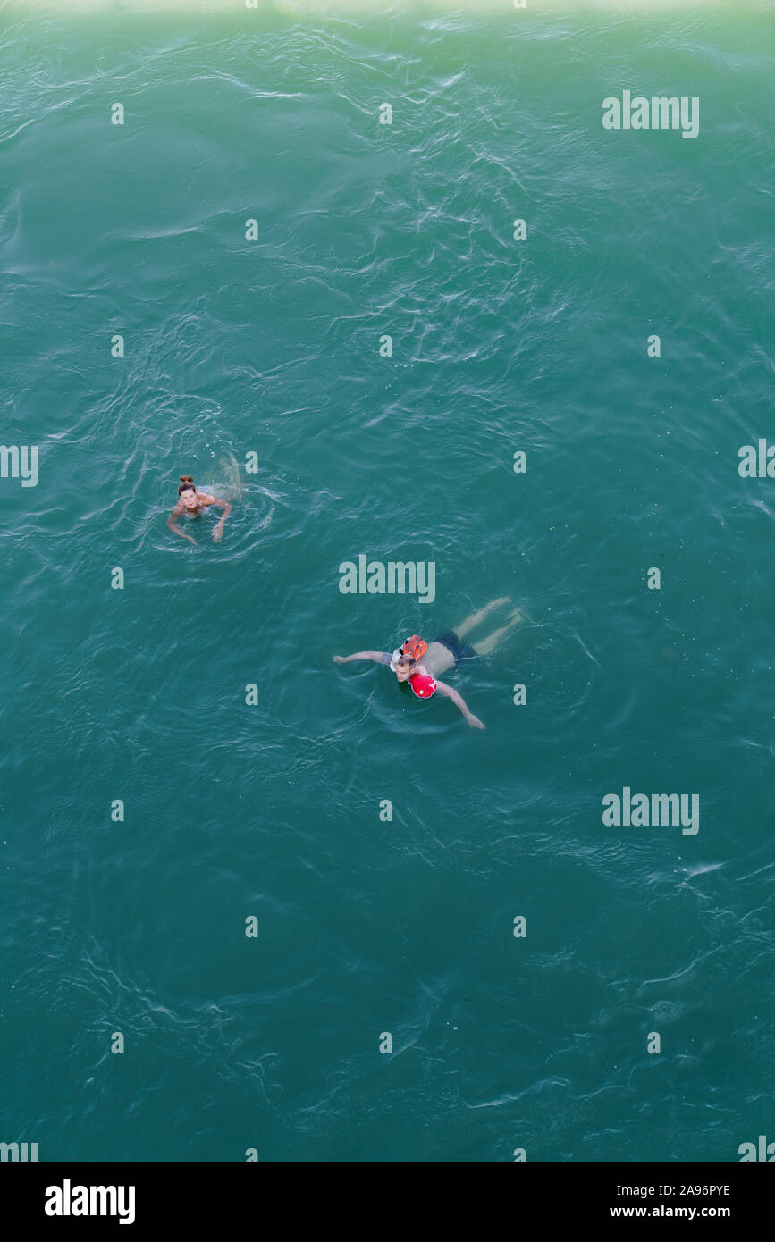 People floating in Rhine river in Basel Stock Photo