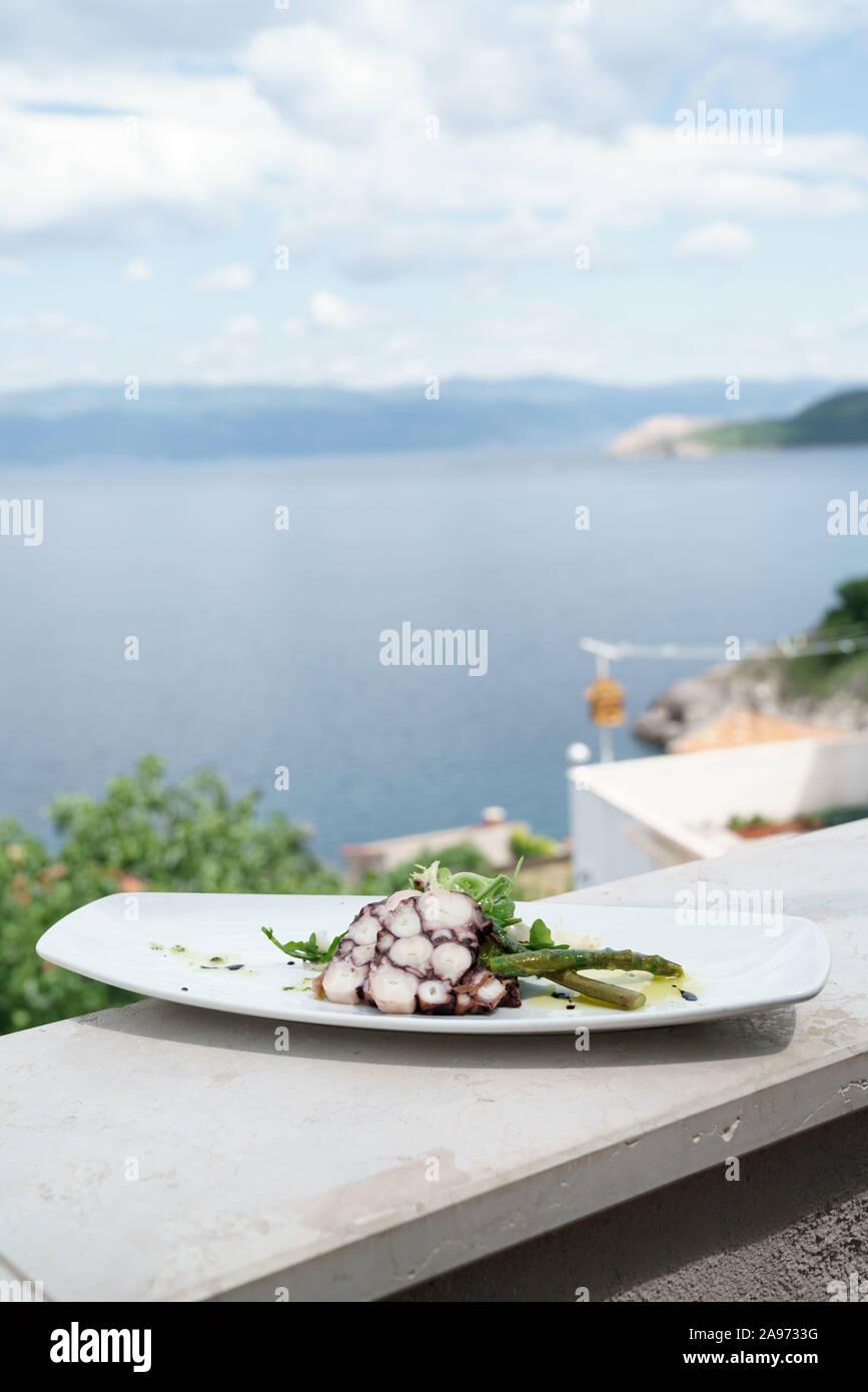Plate of octopus, Konoba Nada, on Krk island, Croatia Stock Photo