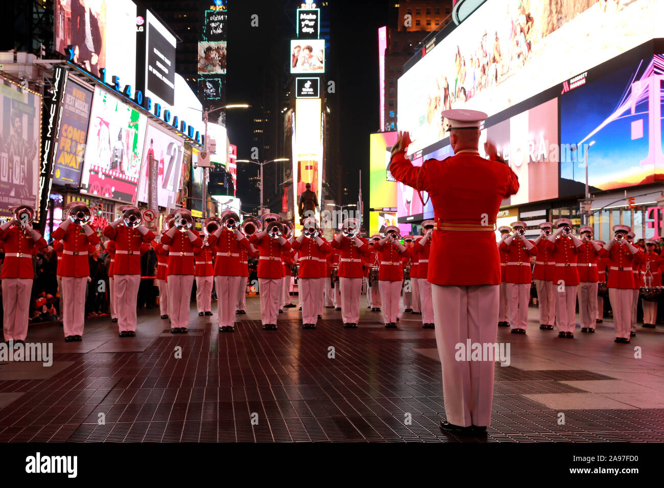 The U.S. Marine Drum and Bugle Corps conduct a musical ballad at Times Square in honor of the Marine Corps' 244th Birthday November 10, 2019 in New York City, New York. Stock Photo