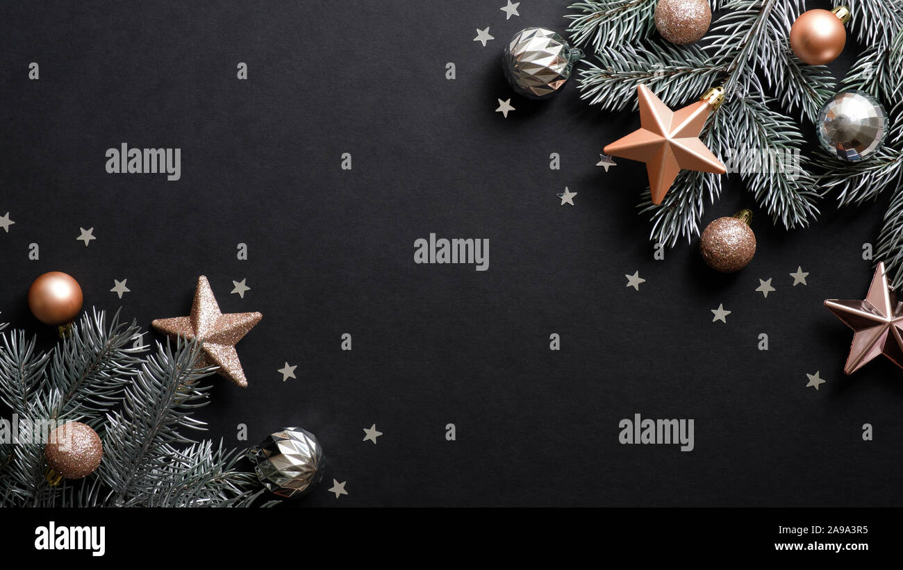 Christmas Banner Christmas Tree Branches Decorated Copper Color Stars And Balls On Black Background Flat Lay Top View Xmas Banner Mockup With Copy Stock Photo Alamy
