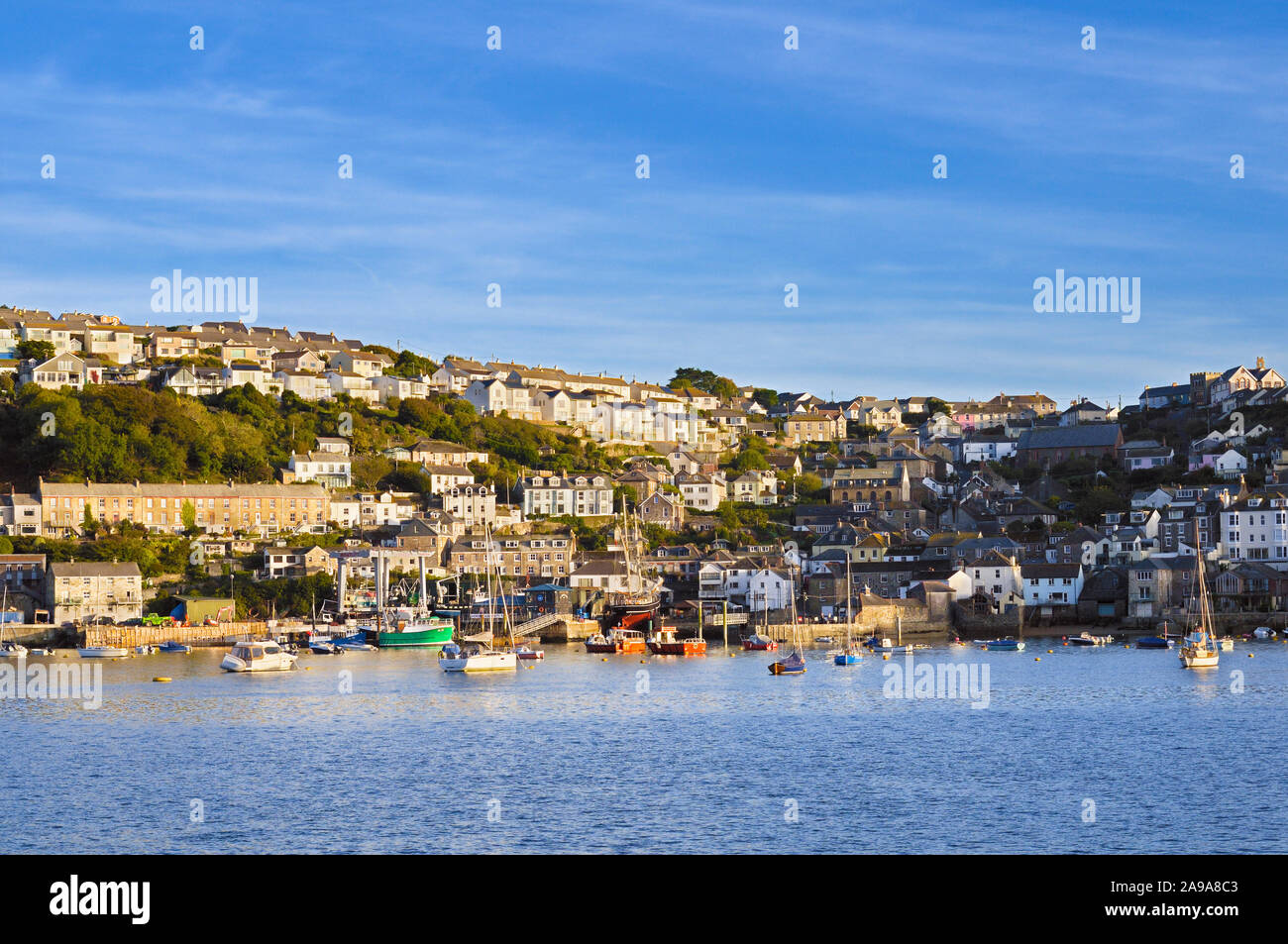 The Cornish fishing village of Polruan viewed from across the river in Fowey, Cornwall, England, UK Stock Photo