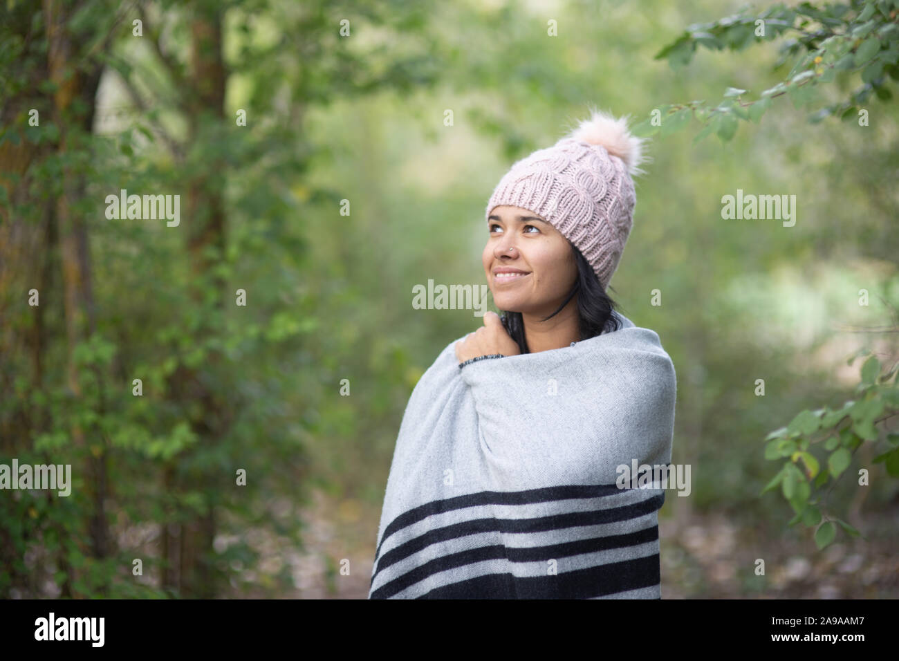 young brunette woman with hat in autumn Stock Photo