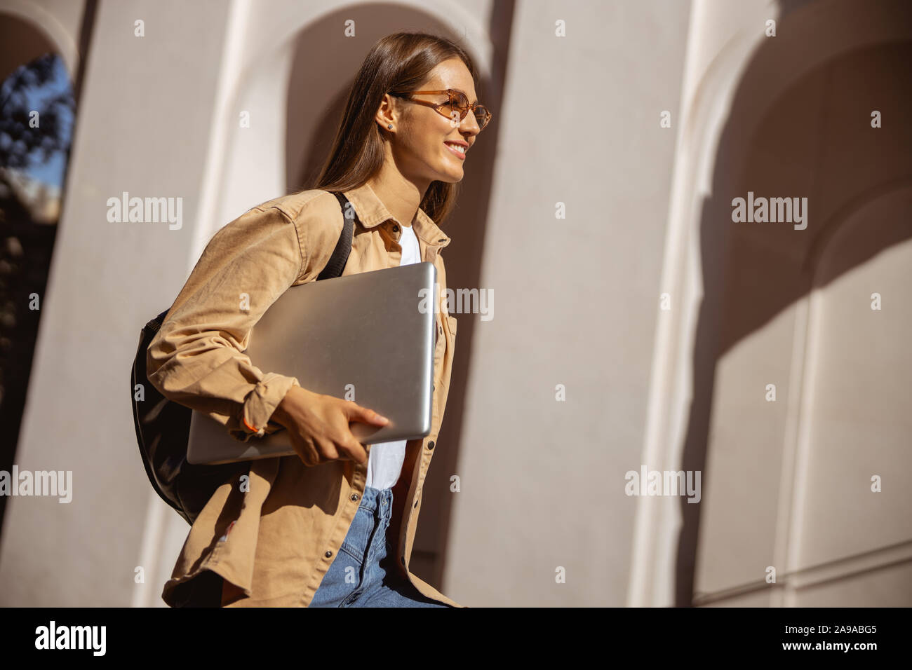 Woman being glad to take a stroll Stock Photo
