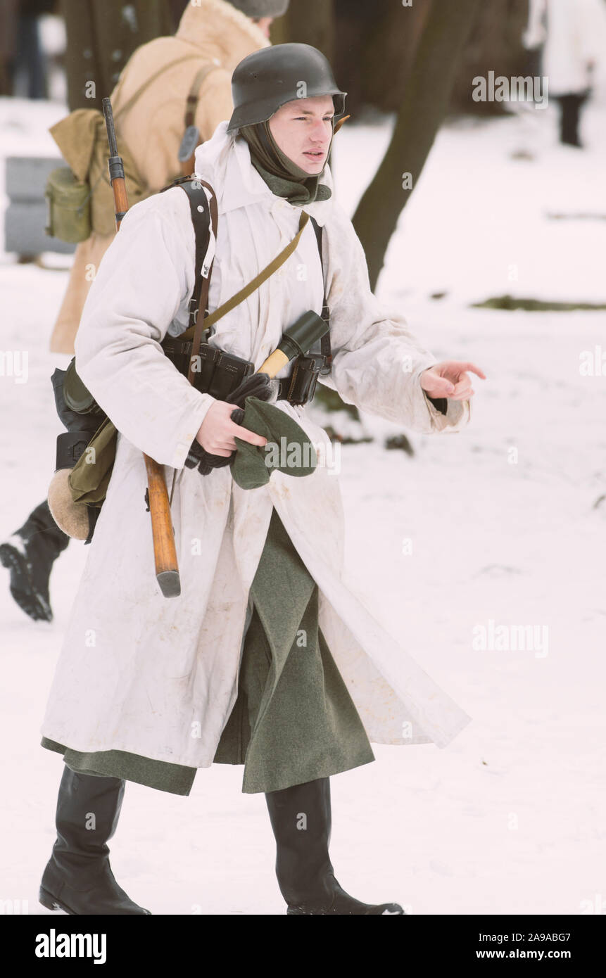 St. Petersburg (Russia) - February 23, 2017: Military historical reconstruction of events of World War II. Armed Wehrmacht soldier in winter camouflag Stock Photo