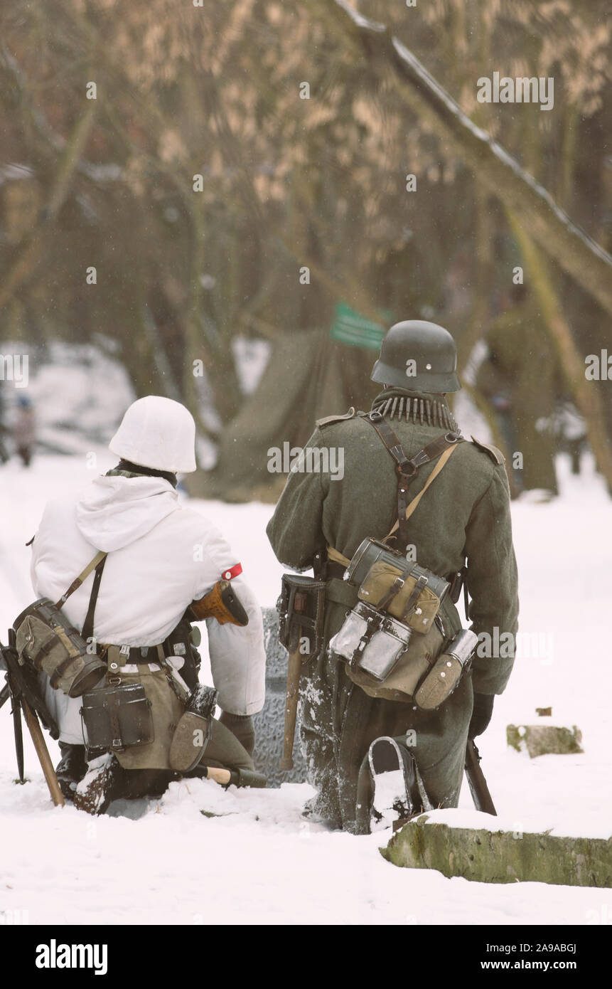 St. Petersburg (Russia) - February 23, 2017: Military historical reconstruction of events of World War II. Two armed soldiers of the Wehrmacht sitting Stock Photo