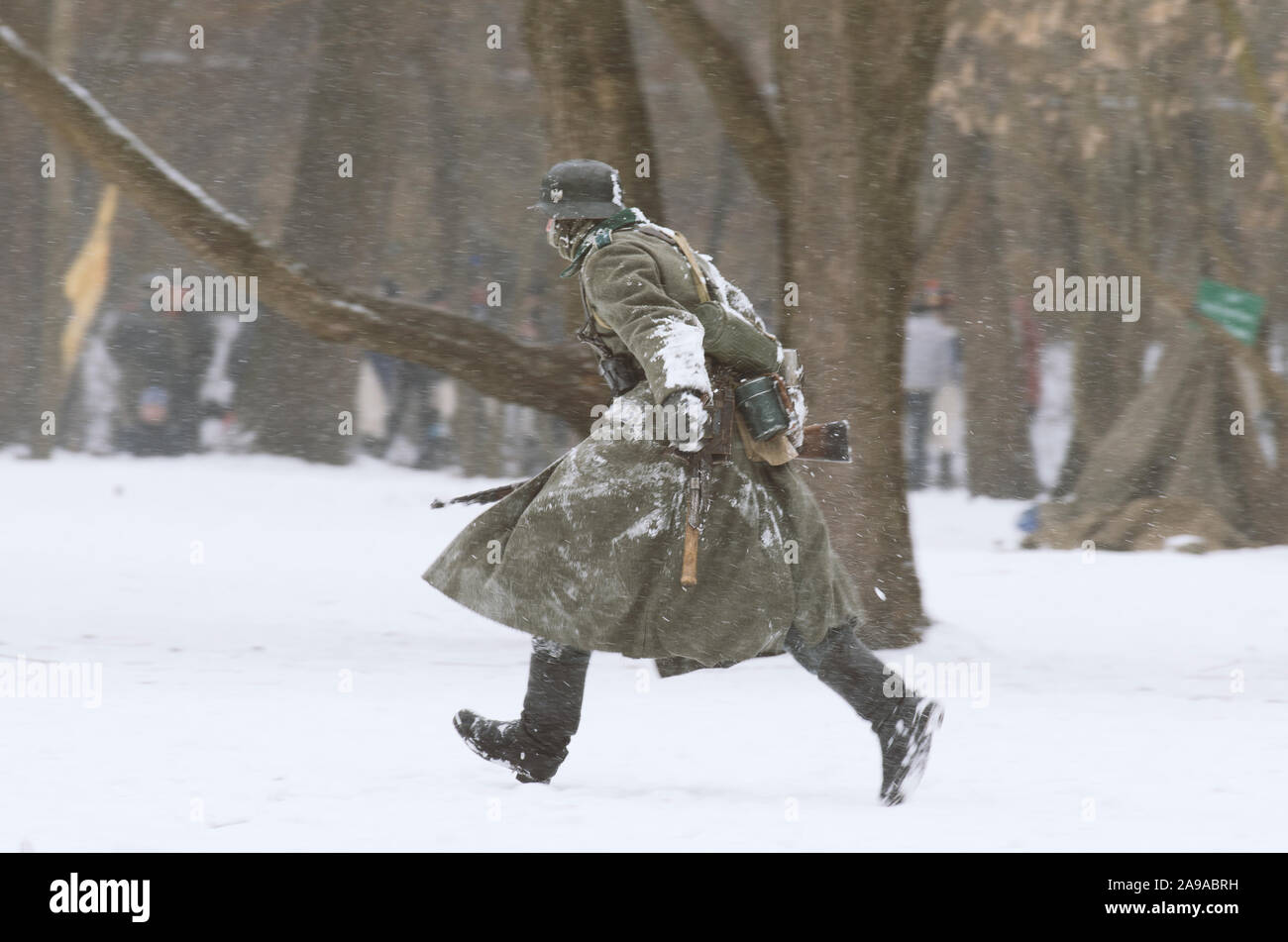 St. Petersburg (Russia) - February 23, 2017: Military historical reconstruction of events of World War II. Running german Wehrmacht soldier with a rif Stock Photo