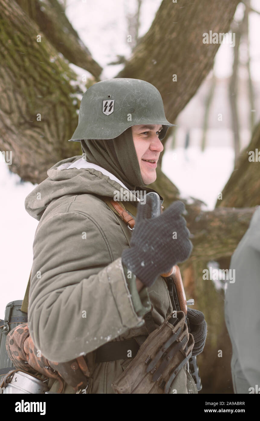 St. Petersburg (Russia) - February 23, 2017: Military historical reconstruction of events of World War II. Wehrmacht soldier with the emblem of the SS Stock Photo