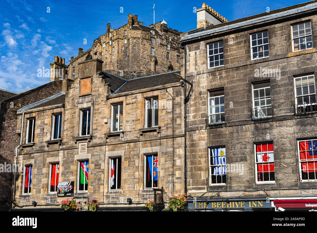 Detail of Historic Buildings in the Grassmarket With Clear Skyline View of Edinburgh Castle With Blue Sky: Edinburgh, Scotland. Stock Photo