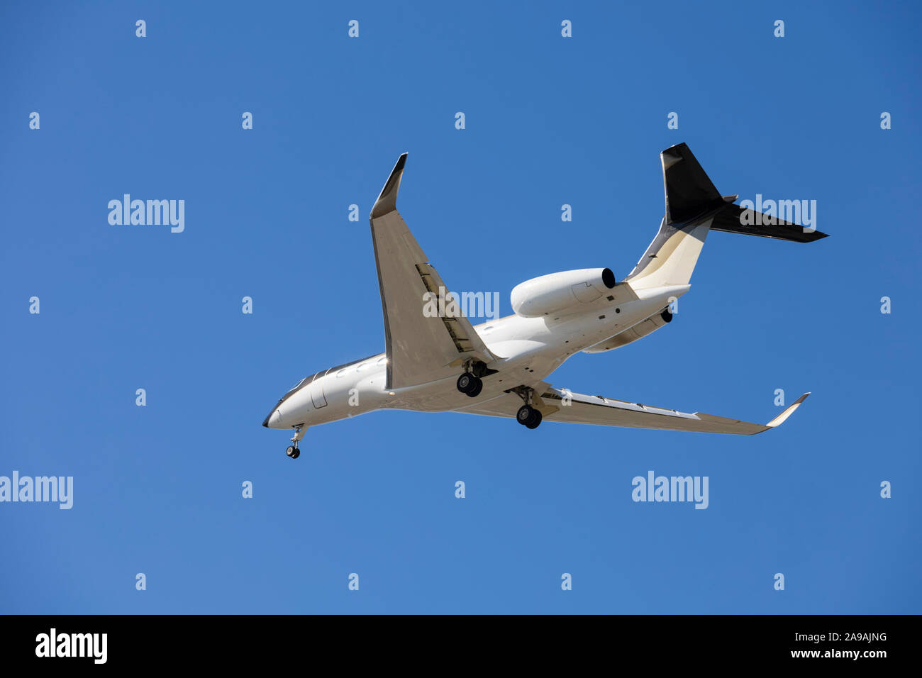 Private jet on approach into LAX, Los Angeles, California, United States of America. USA Stock Photo