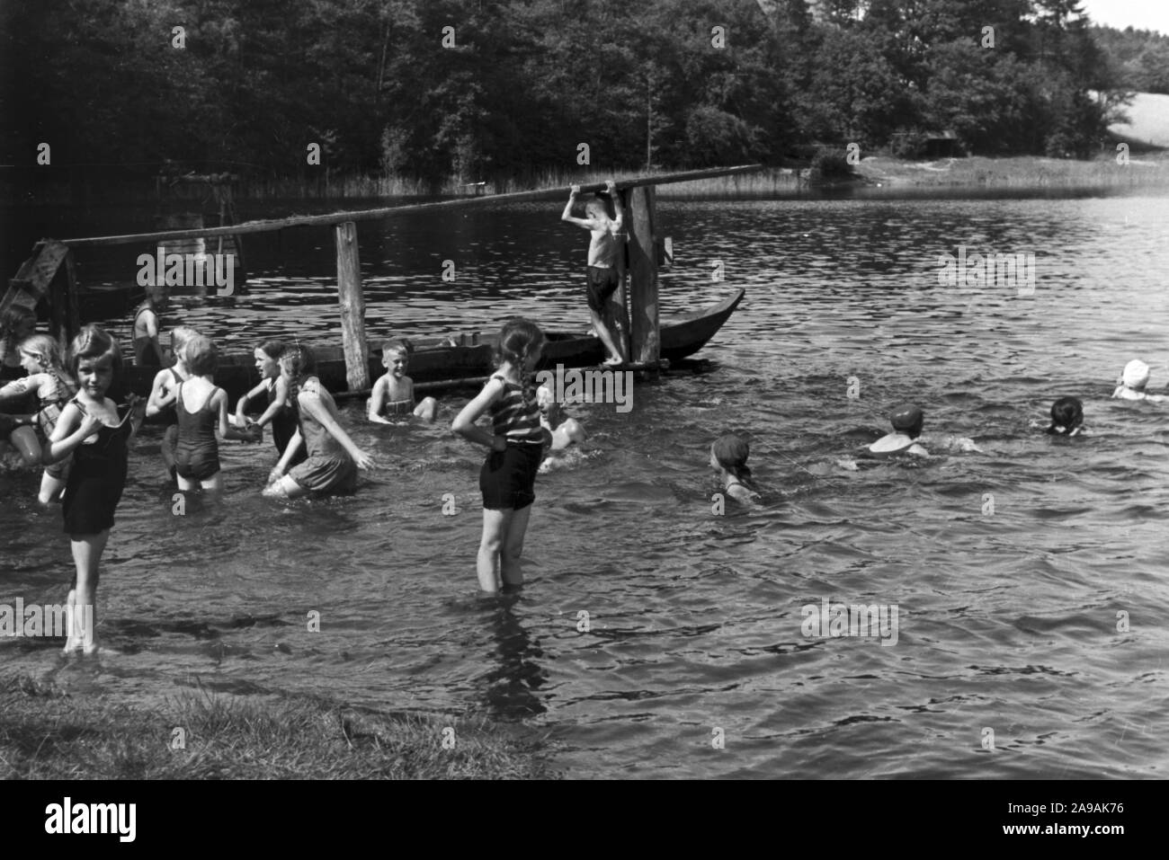 Pupils of the rural school Tiefensee during swimming lessons, Germany 1930s. Stock Photo