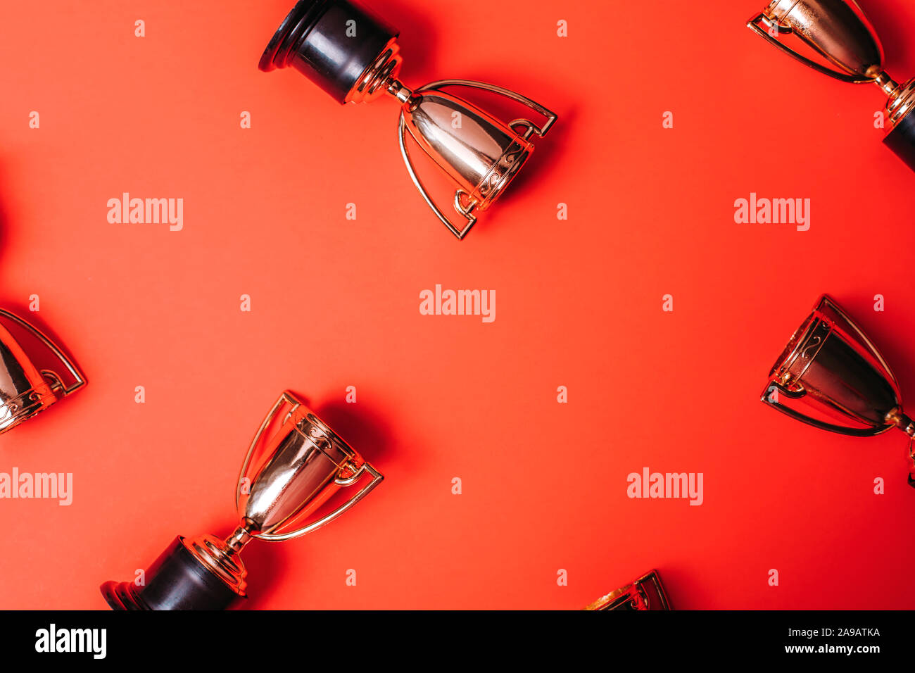 Winner or champion cup on bright background, Flat lay style. Open composition. Stock Photo