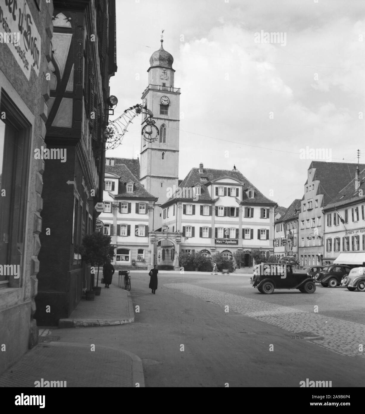 Twin houses near main market with minster St. John Baptist at the city of Bad Mergentheim, Germany 1930s. Stock Photo