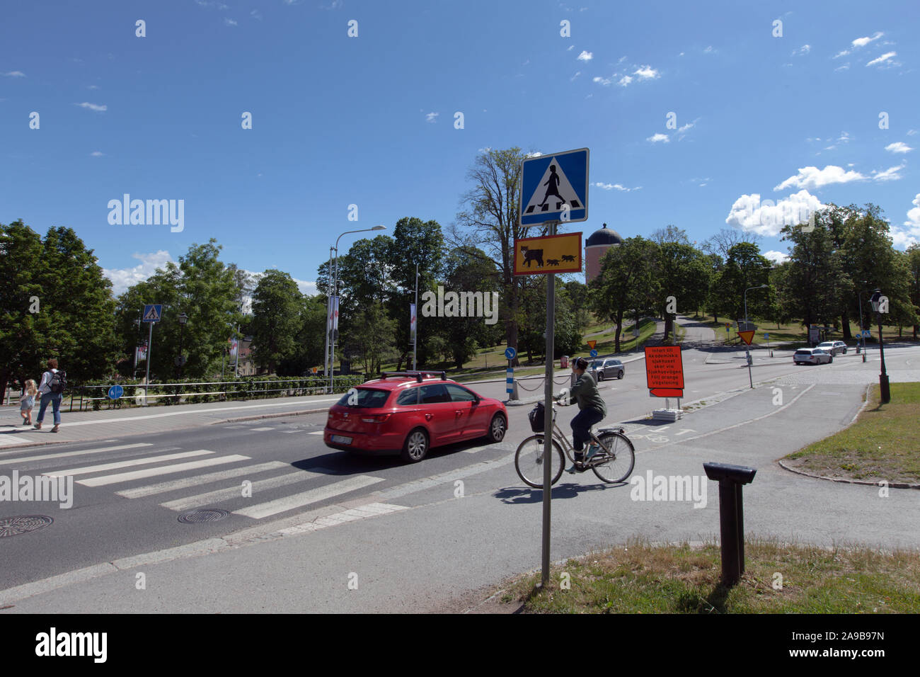 UPPSALA, SWEDEN ON JULY 03, 2019. View of signs and zebra crossing outside Carolina Rediviva. Unidentified persons. Editorial Stock Photo