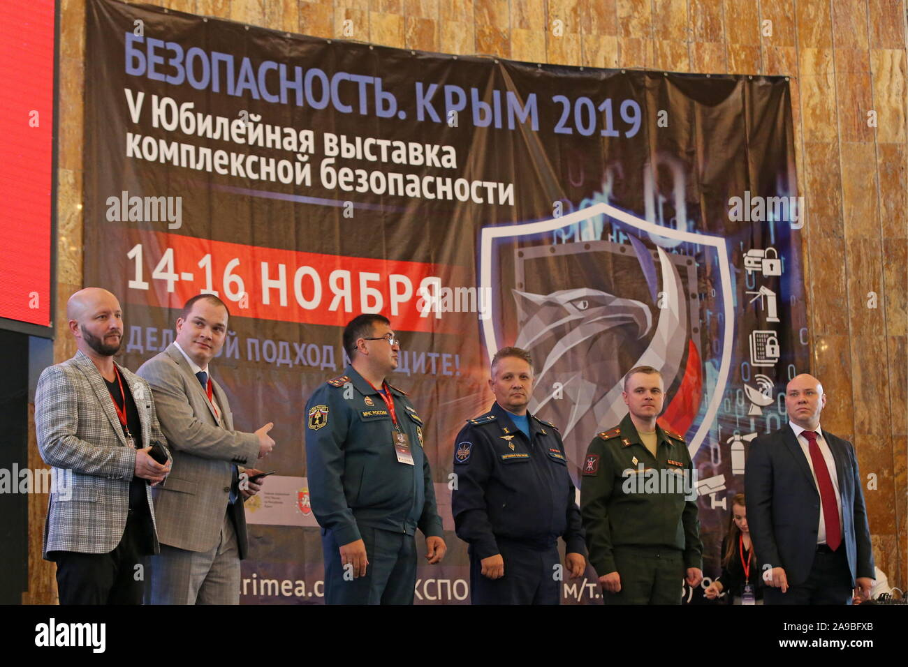"""Yalta, Russia. 14th Nov, 2019. YALTA, CRIMEA, RUSSIA - NOVEMBER 14, 2019: People attend the 5th """"Safety. Crimea 2019"""" integrated security exhibition at the Yalta Intourist Hotel. Individual protective gear, special clothing, firefighting equipment, threat warning systems, video surveillance systems, etc are on display at the exhibition. Sergei Malgavko/TASS Credit: ITAR-TASS News Agency/Alamy Live News Stock Photo"""