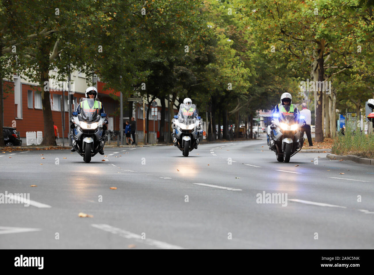 Berlin, Berlin / Germany, September 15, 2018. Berlin police officers on motorcycles securing the Inline Scater race as part of the Berlin Marathon. Stock Photo