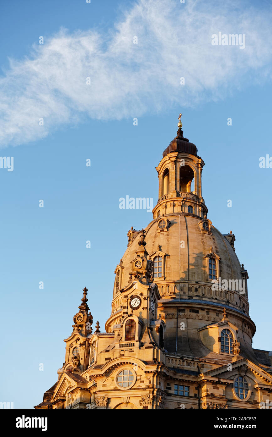 Dresden - View from below onto the dome of the Frauenkirche in the evening light, veil cloud above the dome tower, bell tower in the foreground, Detai Stock Photo