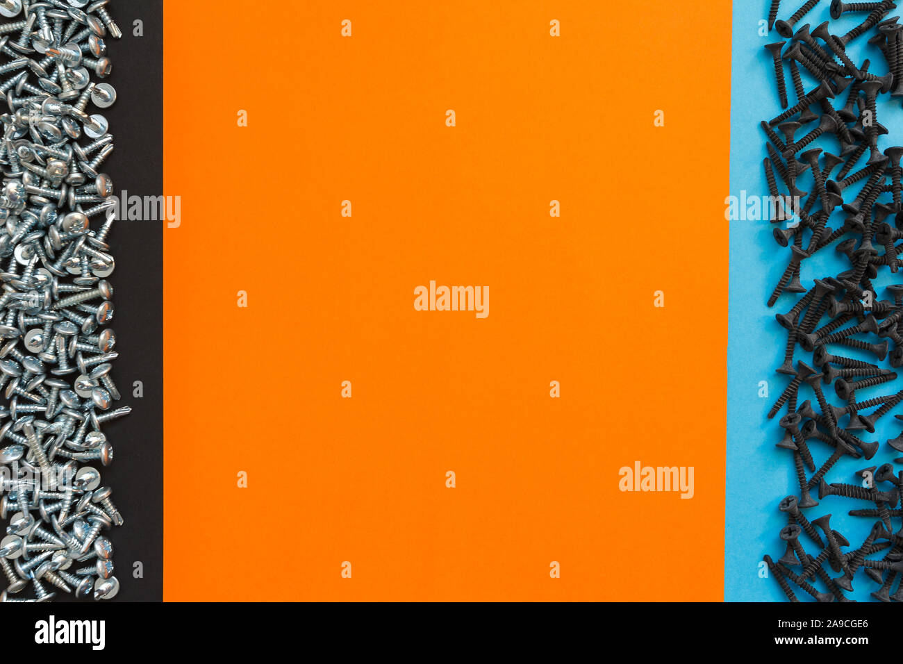Flat Lay Composition With Different Screws on Black, Orange and Blue Background. Top View of Checklist Concept Stock Photo