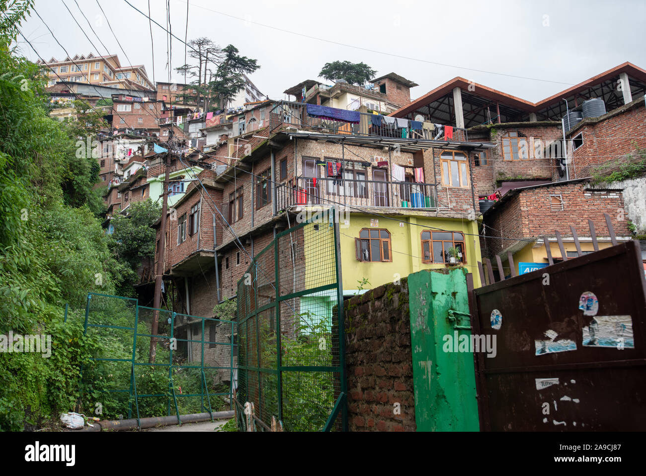 View of houses hugging the hillside Shimla where houses are constructed close to each other Stock Photo