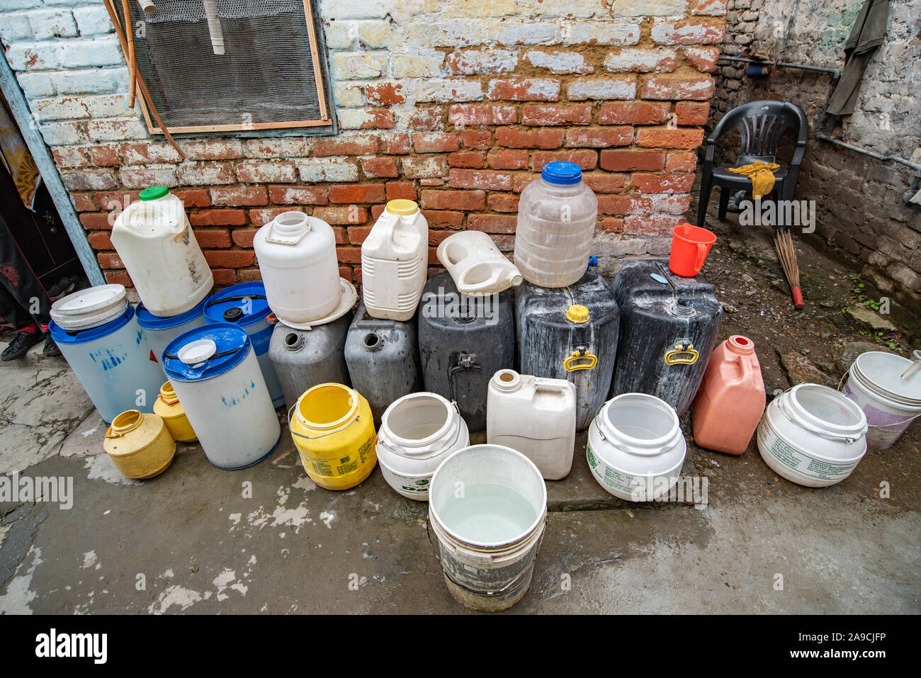 The difficulties of Shimla's residents in accessing clean drinking water is made explicit by these plastic containers outside the home Stock Photo