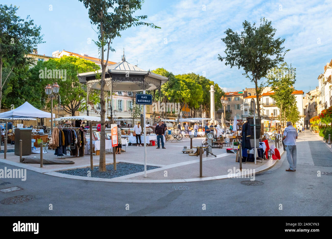 Merchants sell their antiques and collectibles at the Antibes Flea Market at Place Nationale in the seaside village of Antibes, France Stock Photo