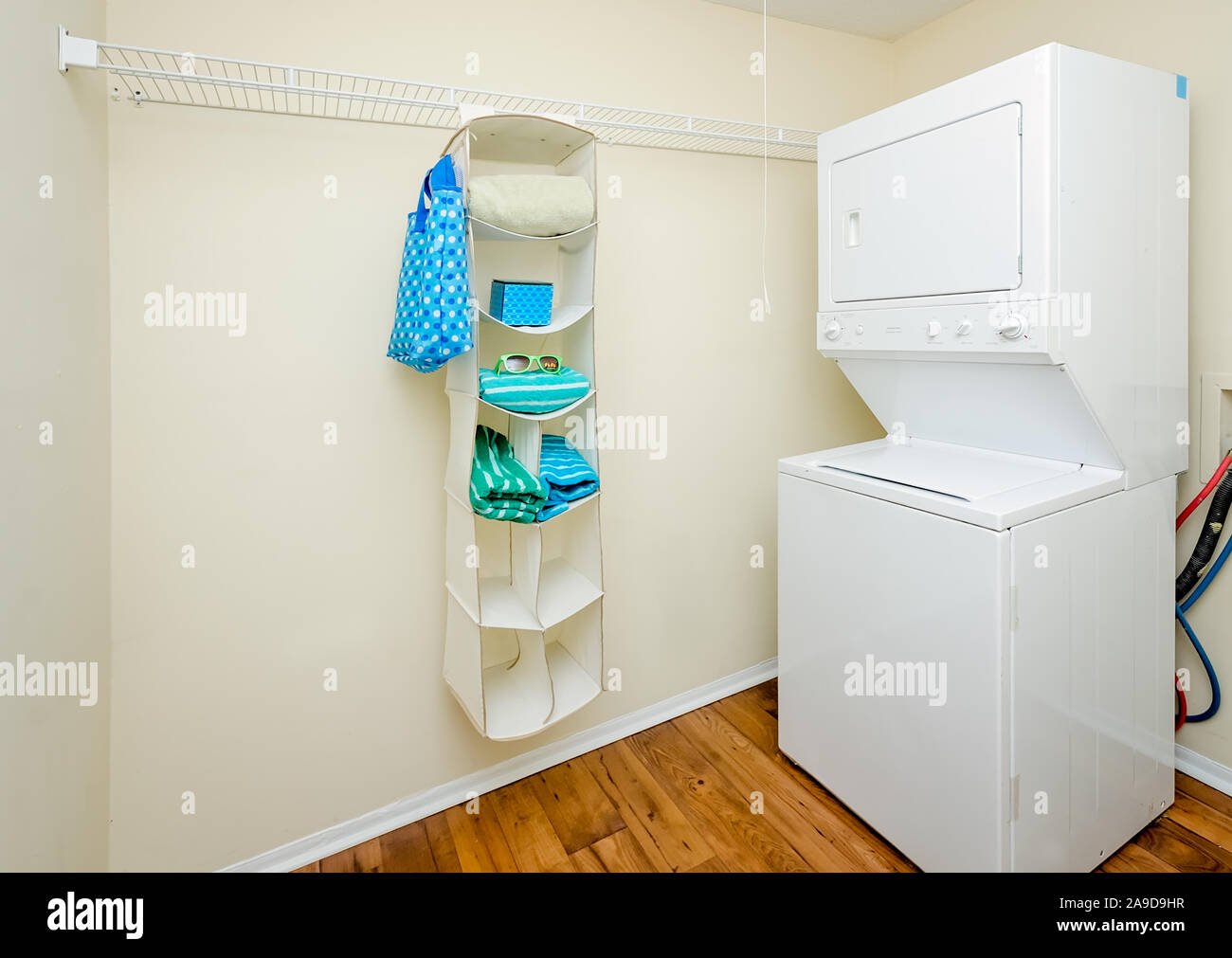 The laundry room features a stackable washer and dryer at ...