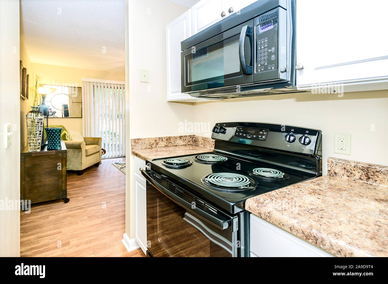 The kitchen features an electric stove at Autumn Woods ...