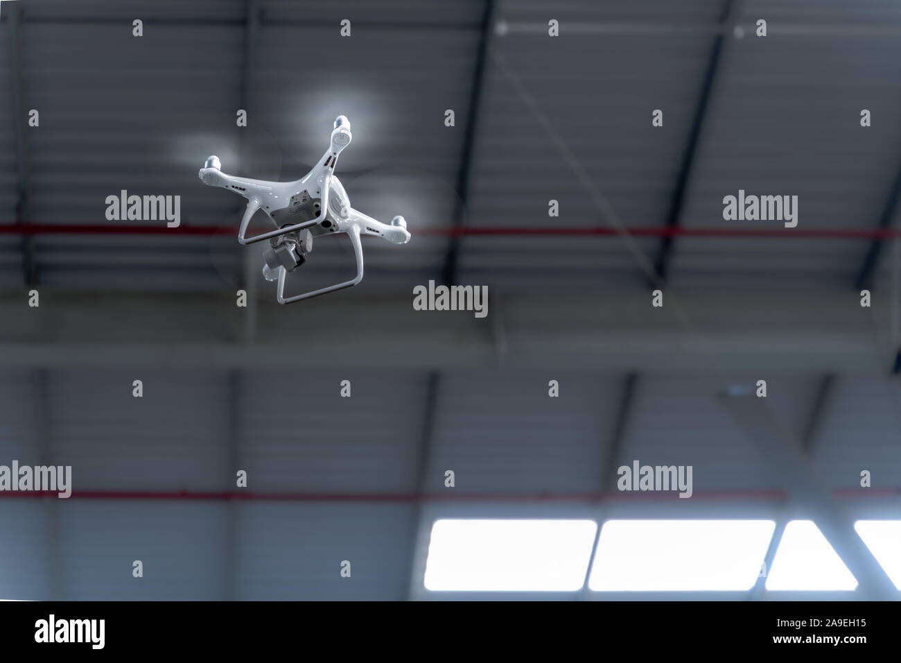 Drone camera surveying over a smart factory using internet of things Stock Photo