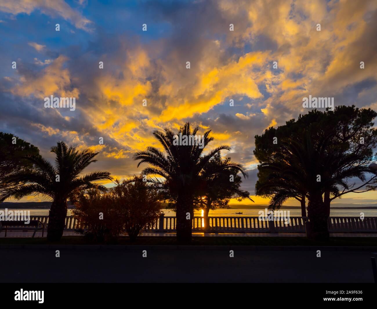 Crikvenica in Croatia evening sunset waterfront seaside promenade scenery Stock Photo