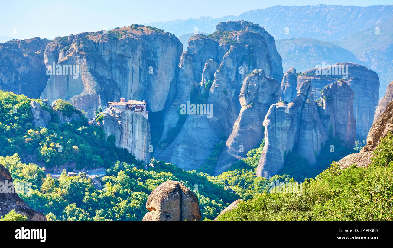 Panoramic view of the rocks of Meteora with The Monastery of Roussanou on the top of the cliff, Greece -  Greek landscape Stock Photo