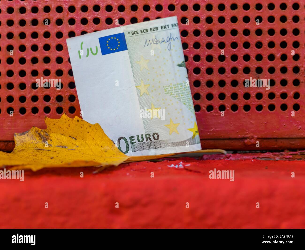 Lost and found money and fallen leaf Stock Photo