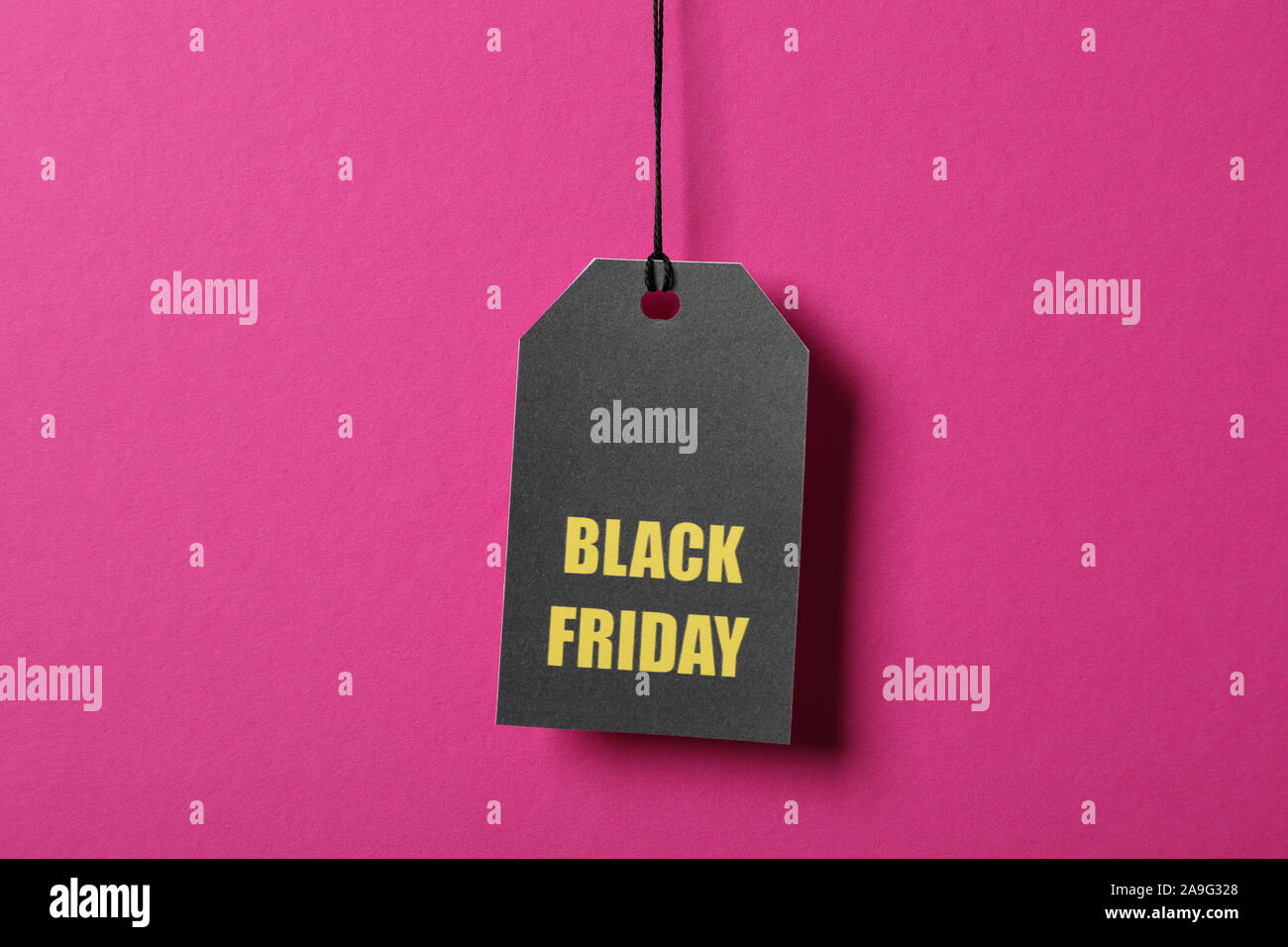 Inscription Black Friday on price tag on pink background, copy space Stock Photo