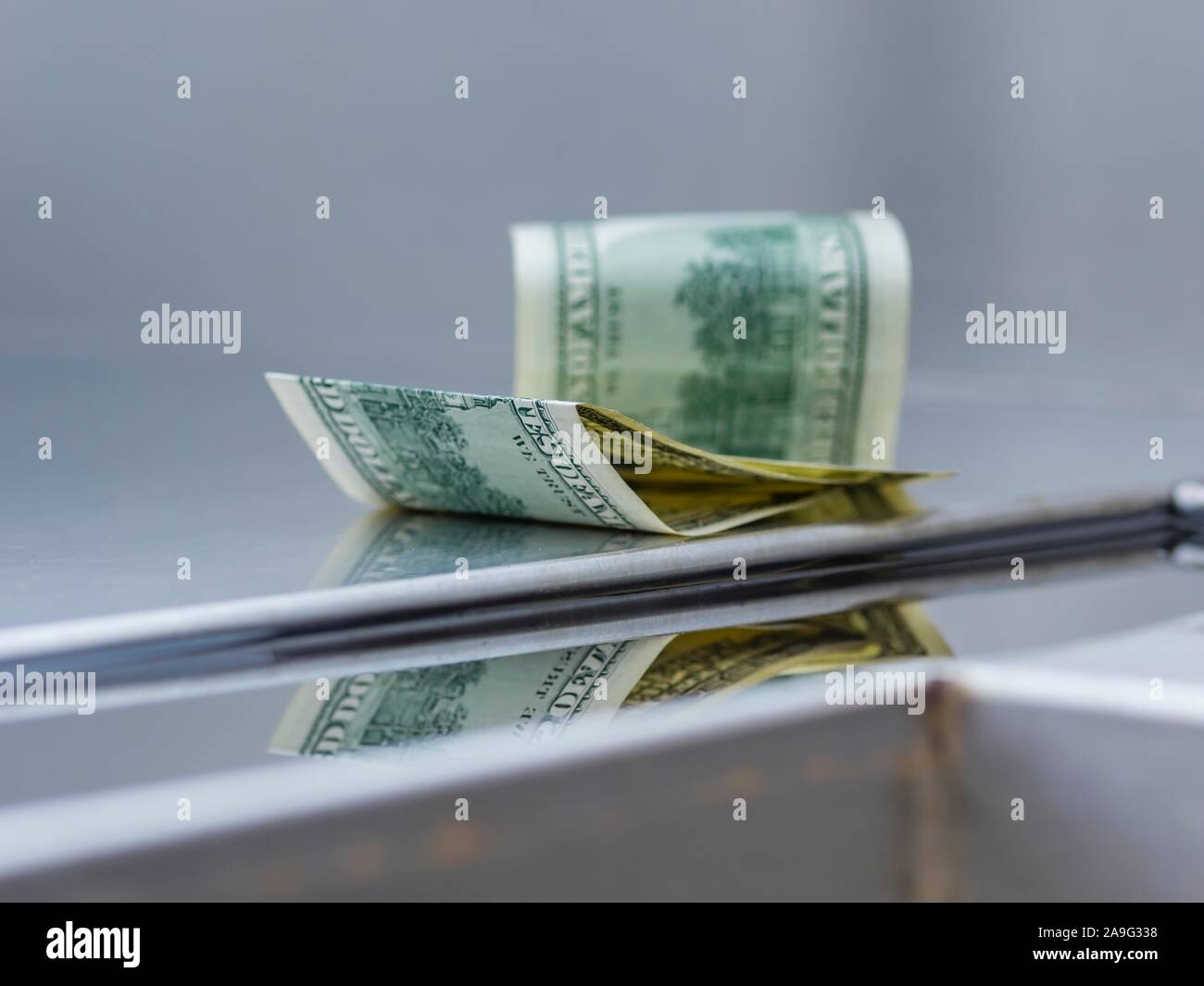 Lost and found money reflection Stock Photo
