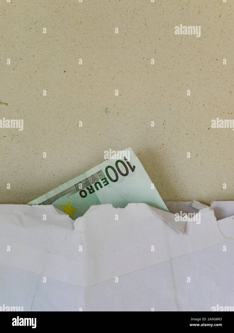 Money in paper envelope with hard-jagged edge Stock Photo