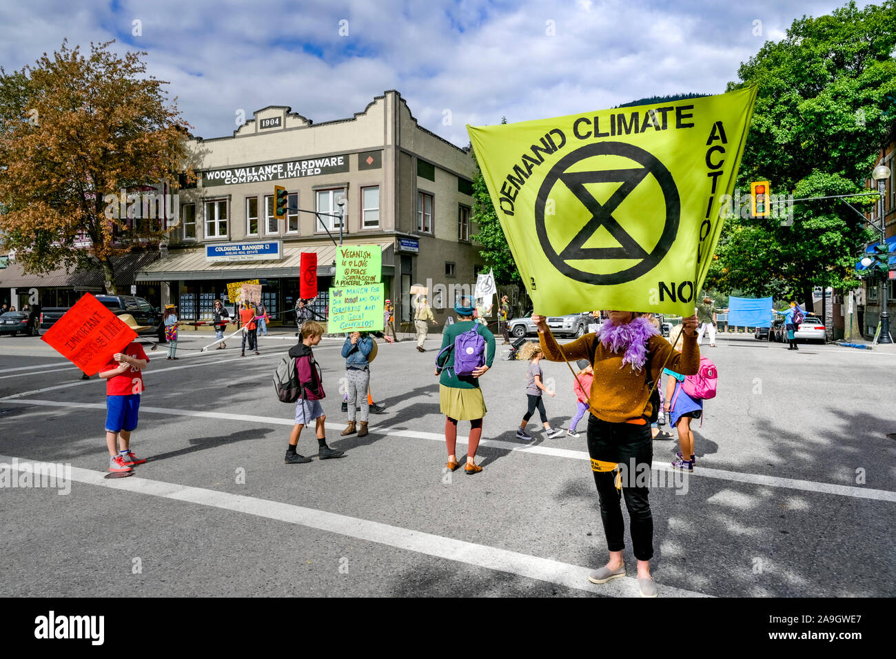 Extinction Rebellion activists occupy and shutdown downtown intersection for four minutes to highlight need for change, Nelson, British Columbia, Cana Stock Photo