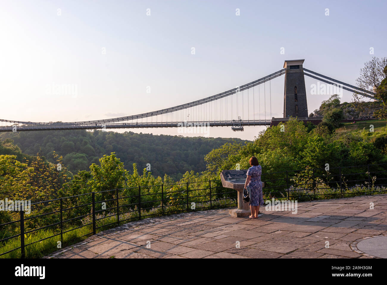 Woman reading the information about Clifton Suspension Bridge,  design by William Henry Barlow and John Hawkshaw, Clifton, Bristol, England, UK Stock Photo
