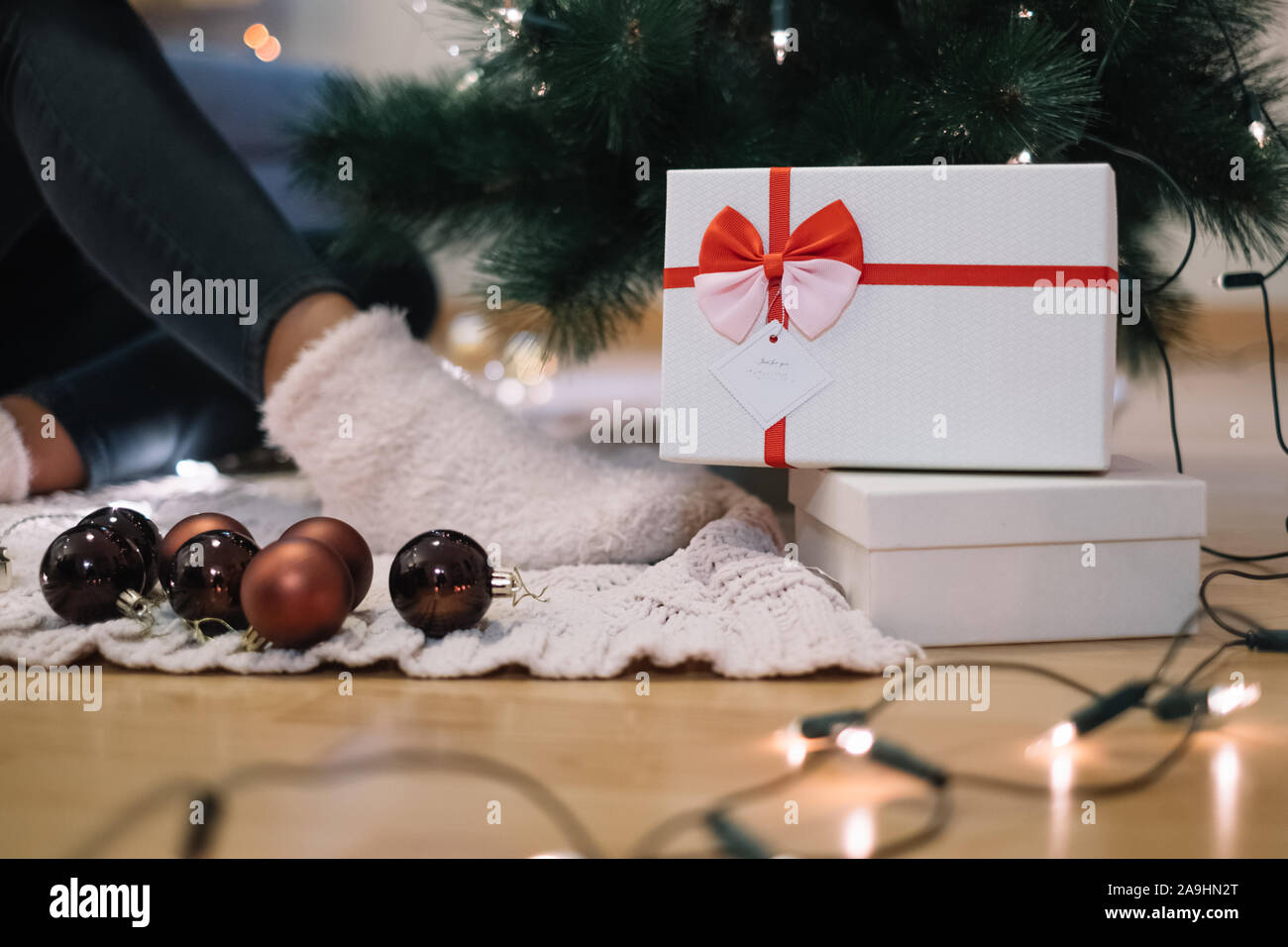 Christmas ornaments and lights with gift boxes Stock Photo