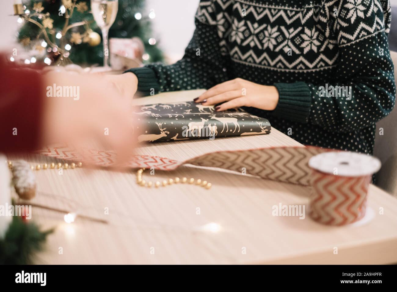 Cropped photo of woman packing Christmas presents Stock Photo