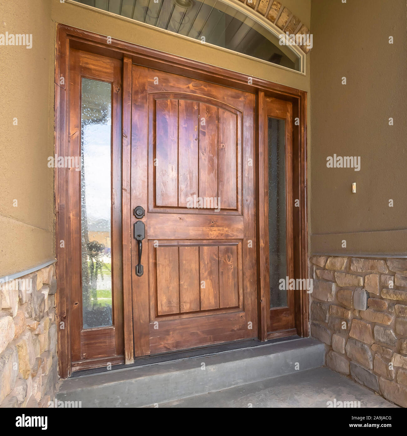 Square Frame Home Porch And Brown Wood Front Door With Sidelights And Arched Transom Window Stock Photo Alamy