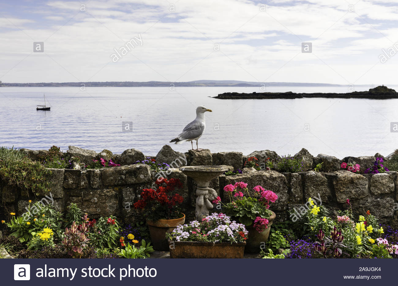 looking from gurnick street to st. clement's island, mousehole / porthenys, penzance, mount's bay, cornwall, england, great britain, uk Stock Photo