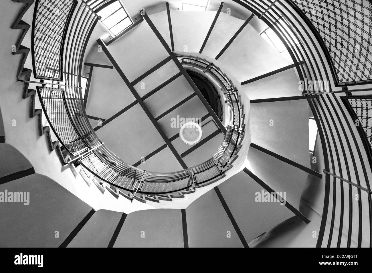 Black and white photograph of spiral ladders Stock Photo
