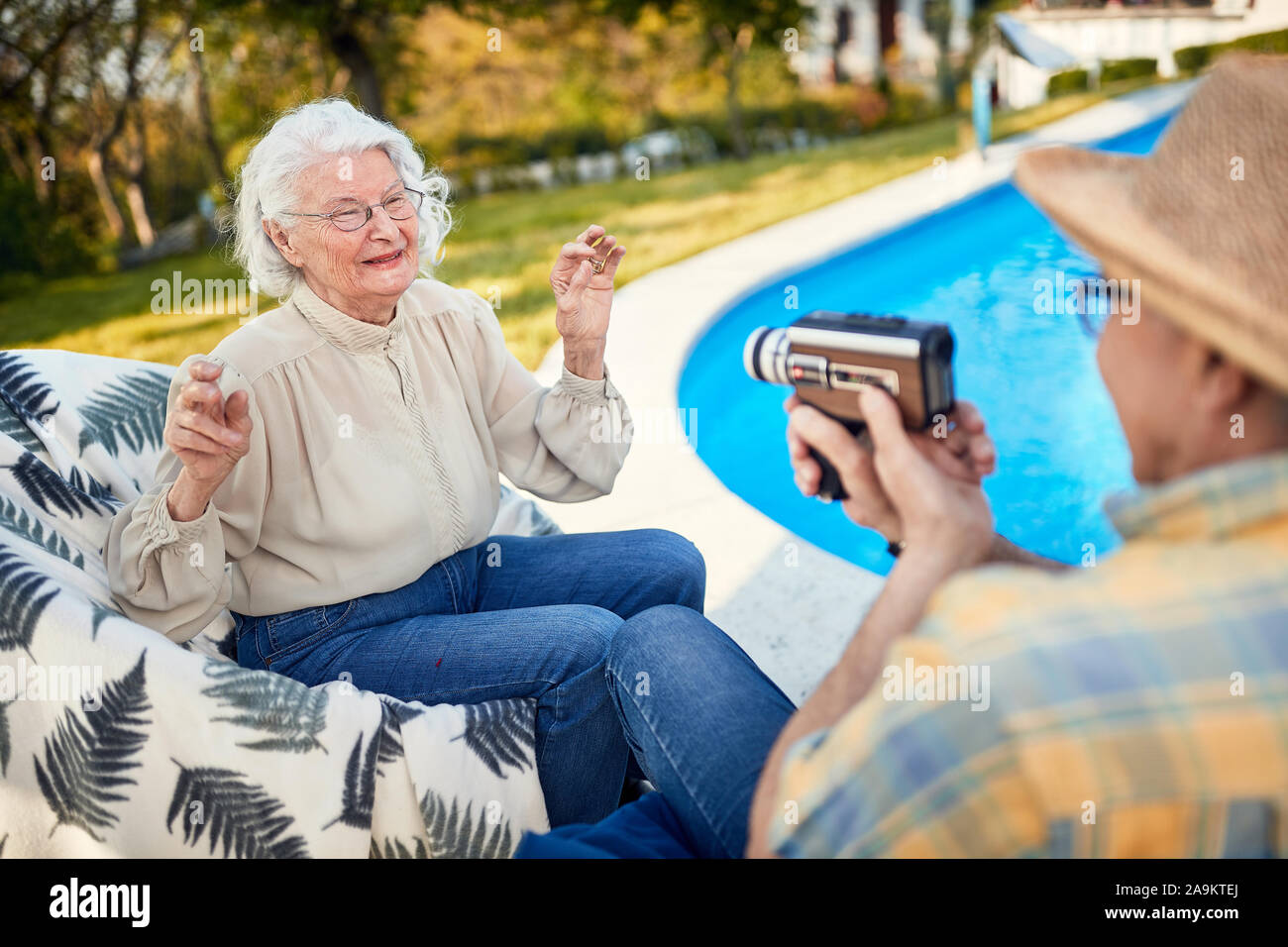 Smiling Elderly Couple Have Fun At Holiday And Captures With A