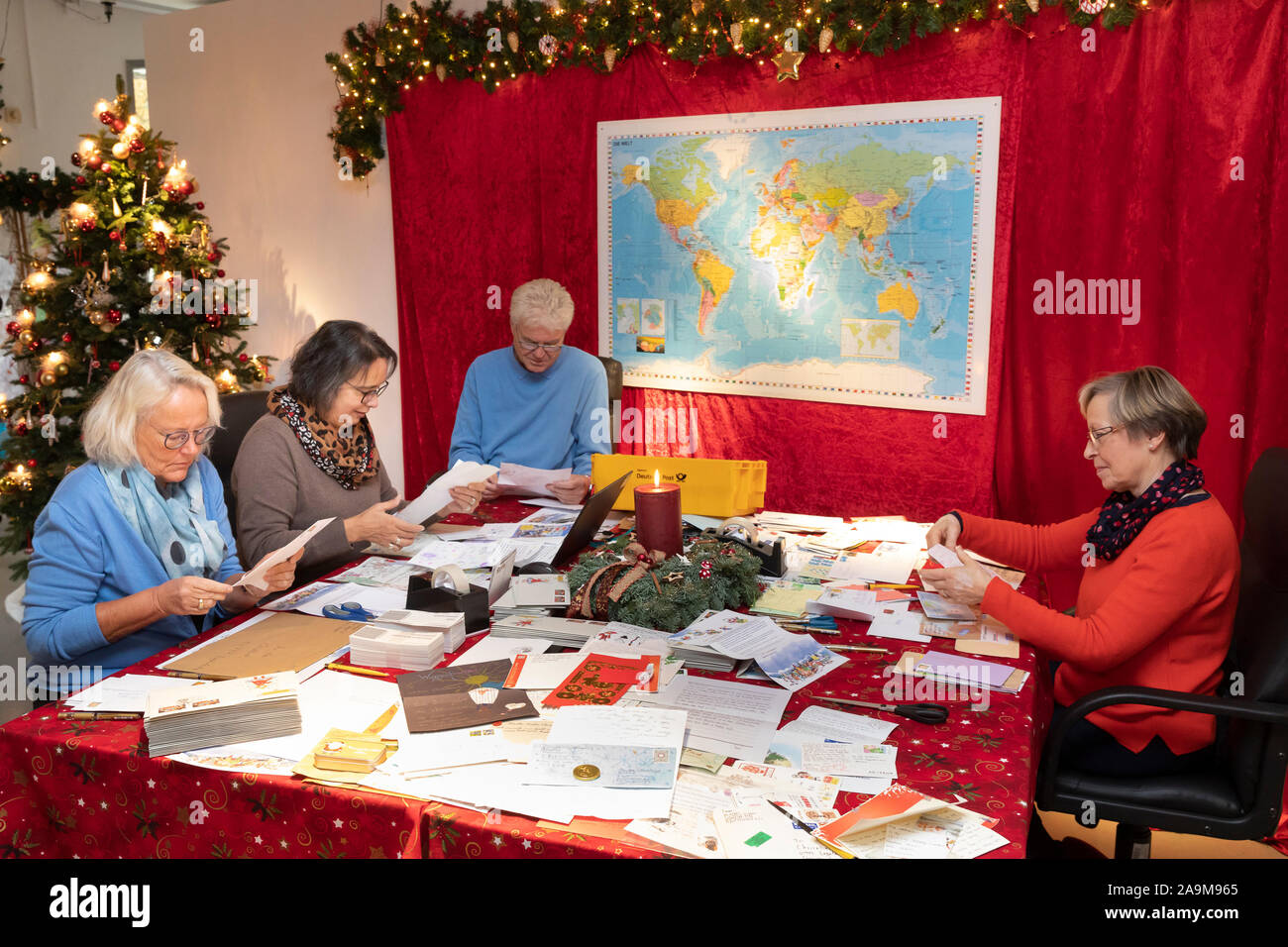 The Christkind post office in Engelskirchen in the Bergisches Land has resumed its work. People reading and answering the letters Stock Photo