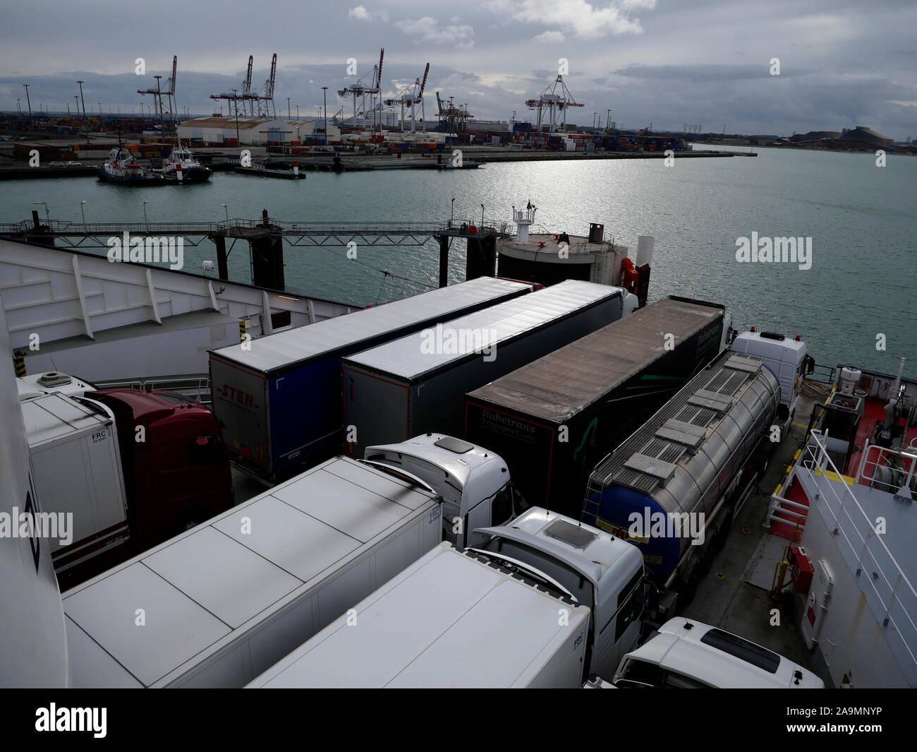 AJAXNETPHOTO. OCTOBER, 2019. DUNKERQUE, FRANCE. - CHANNEL FERRY CARGO - FREIGHT TRUCKS PARKED ON THE DECK OF A DFDS DOVER BOUND FERRY AS IT LEAVES THE PORT.PHOTO:JONATHAN EASTLAND/AJAX REF:GX8 191510 20908 Stock Photo