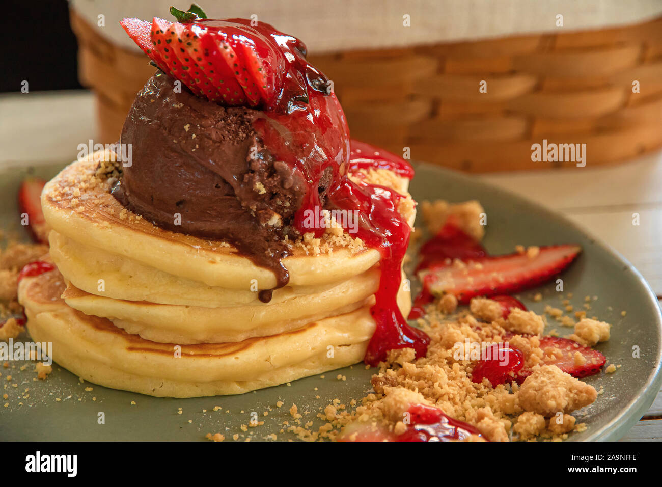 Chocolate Ice Cream On A Pancake With Strawberry Jam On Top Stock Photo Alamy
