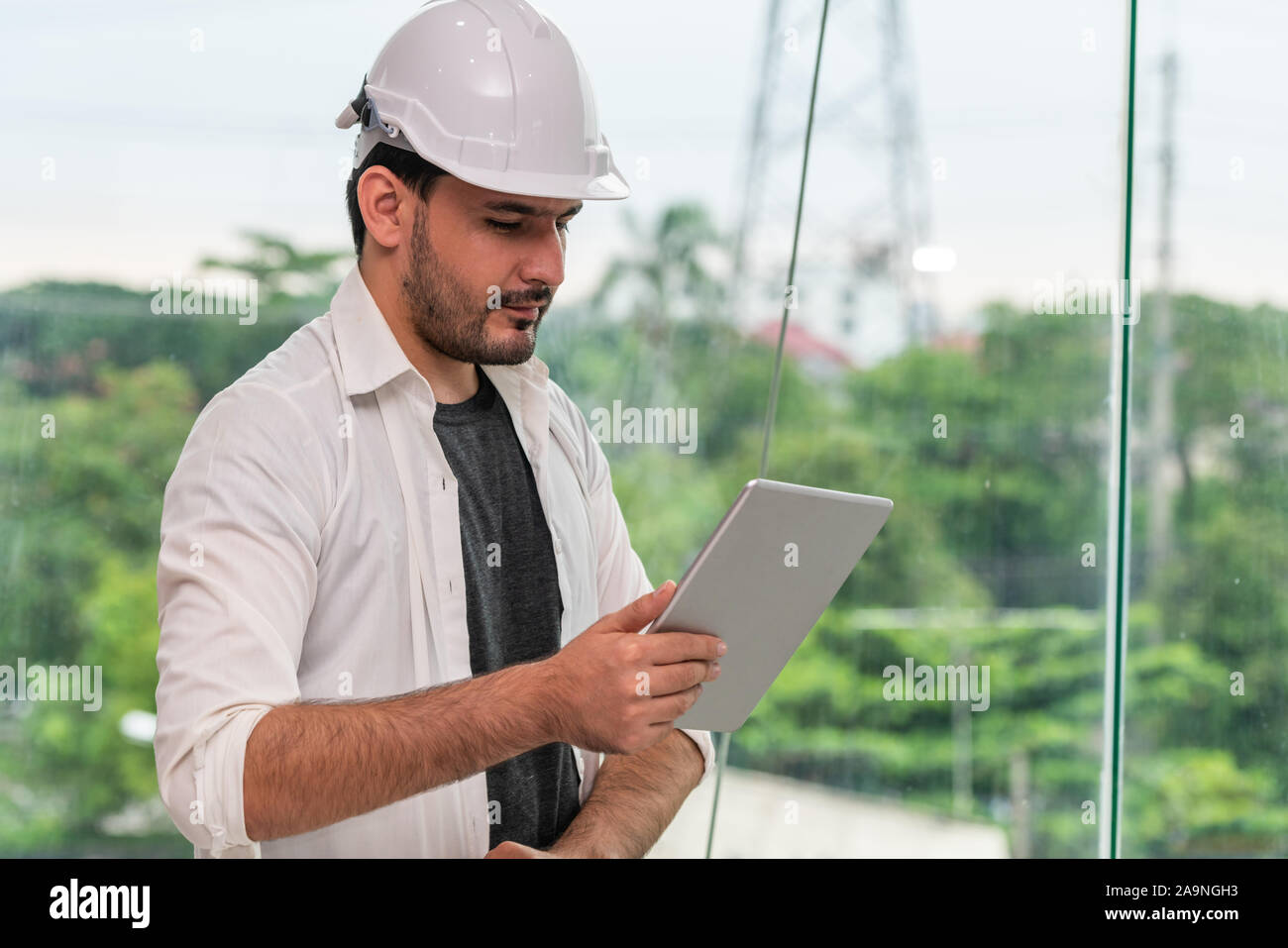 Young Man Architect Or Engineer Working With Tablet Computer To Make Interior Design At Workplace Real Estate Business And Civil Engineering Concept Stock Photo Alamy